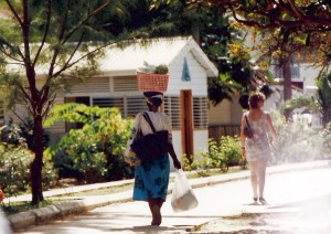 A contrast of cultures -- a local woman on Martinique and a tourist.
