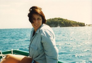 Karen in our dinghy in the Cays